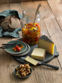 Pickled vegetables and spiced nuts and cheese