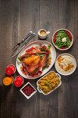 Roast turkey with orange glaze and side dishes