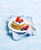 Pancakes with berries and coconut yoghurt