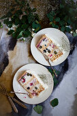 Two slices of cream cake on plates
