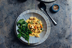Thai curry coconut chicken withj fresh baby spinach