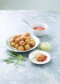 Deep-fried tempeh balls with a tomato and rocket dip