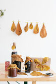 Preserving jars and gift decorated with autumn leaves