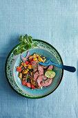 Chilli cumin rib-eye steaks with corn and bean salad (Brazil)