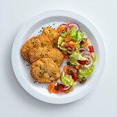 Sicilian-style chicken escalope with Mediterranean salad