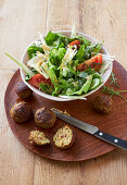 Fennel salad with minced meat and curry balls