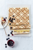 Blueberry cake with cinnamon cream with a filigree pattern