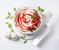 Yoghurt and meringue ice cream with sour cherries