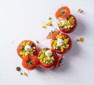 Tomatoes filled with vegetables and mozzarella