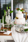 A three-tier cake on a festively laid table