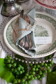 Festive, autumnal place setting decorated with young grapes