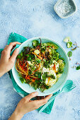 Detox diet: salad with avocado, Brussels sprouts and poached egg