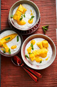 Lemongrass and coconut rice pudding with mango (Asia)