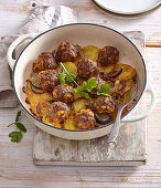 Beef meatballs with chorizo and cheese on a bed of potatoes