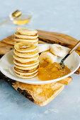Mini pancakes with mango pineapple jam and banana