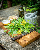 Ingredients for lovage pesto on an outdoor table
