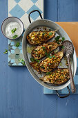 Stuffed aubergines with rice, turmeric, nuts and dates