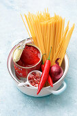 Ingredients for spaghetti in bacon and tomato sauce (one pot pasta)