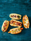 Five hot dog varieties - Japanese, Danish polser, Queensland snag, Argentinian choripan