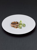 Marinated shoulder of suckling pig with savoy cabbage purée