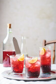 Fruit juice with ice cubes and lemon