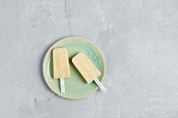 Homemade Banana Popsicle on White Background