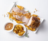 Roast veal with walnuts and vanilla pears