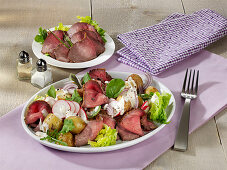 Roast potato salad with roast beef and radishes