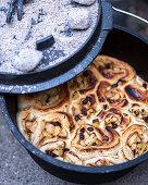 Preparing cinnamon buns in the Dutch oven