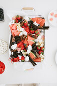 Kids platter with strawberries, watermelon, popcorn and oreco cookies
