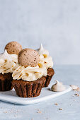 Chocolate peanut butter cupcakes decorated with french macarons