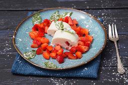 Sweet asparagus cream with fresh strawberries