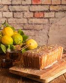 Lemon and poppy seeds cake garnished with sugar glaze and lemon zest