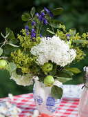 Arrangement of summer flowers and apples