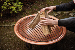 Building logs on a grill grate for the perfect grill fire
