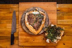 Porterhouse steak grilled in a salt crust
