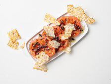 Tomato and balsamic salad with carasau bread chips