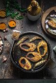 Fish fry on a cast iron tawa