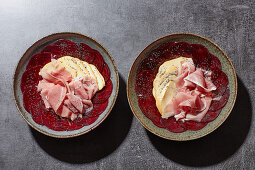 Beetroot carpaccio with scamorza, smoked ham and poppyseeds