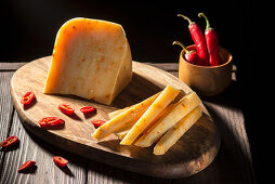 Hard cheese with chilli, in one piece and in sticks