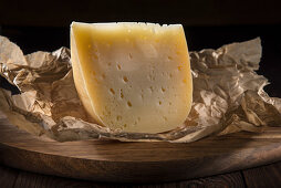 A wedge of hard cheese (quarter fat)