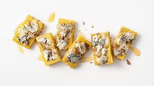 Polenta slices with chestnuts, gorgonzola and honey