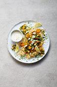 Fried vegan carrot and kale with wholemeal bulgur and soya yoghurt dip