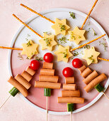 Christmas snacks on stick with cheese and sausages
