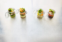 Four XL to-go salads in jars