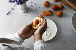 Apricot dumplings being made: dumplings being filled with apricots