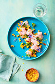 Peruvian ceviche salad made from bass with honeydew melon
