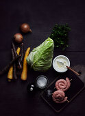 Ingredients for pointed cabbage stew with bratwurst snails