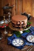 A chocolate cream cake with ganache