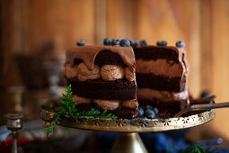 A Christmas chocolate cream cake with ganache and blueberries